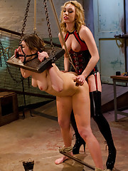 Youthful lesbian domme dominates older women by over the knee spanking, foot and ass licking then first time strap-on sex!