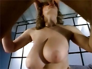 Chick with massive titties sucks a stiff cock