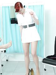 Geeky redhead nurse gives a handjob