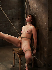 18yr old is given the chair treatment.  A neck rope limits her breathing, this makes her cum harder and often.  So few years, but a rope slut already.