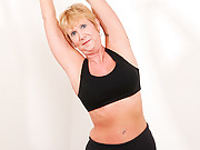 Athletic granny follows her workout with a masturbation session