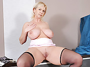 Naughty mom in glasses slips off her mini skirt and masturbates