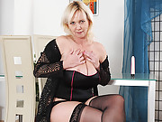 Hot cougar Kimi sucks her dildo and stuffs it in her pussy