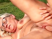 Sexy granny gets fucked outdoors