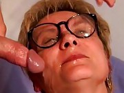 Granny enjoys double facial cumshots