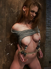 Sexy little redhead with cute freckles, bound tightly, gagged, made to cum! Her puffy big nipples are clamped & weighted! Legs spread and helpless!