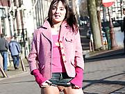 Cutie exposing her teenage snatch on a street