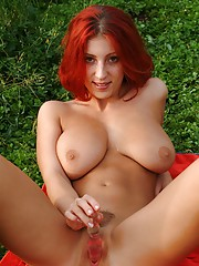 Gorgeous redhead pleasures her cooch and tits