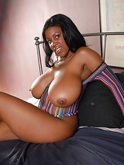 Busty ebony cutie showing off her big titties