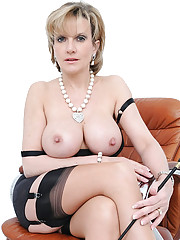 Mature dominant in black lingerie