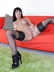 Horny guy banging hottie on a big red couch