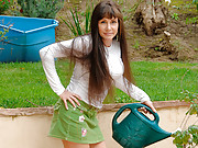 Naughty housewife Alexandra Silk plays with her hairy pussy outdoors