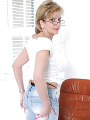 Skintight jeans on a leggy mature