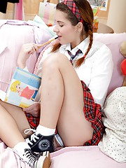 Innocent schoolgirl strokes her young pussy