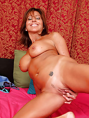 Tara Holiday slips off her lingerie to show us her pretty landing strip pussy