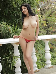Natalia Spice slides out of her red top to play with her wet pussy