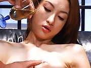Nene Asian babe has oil poured on her body and has tits aroused