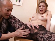 Emi Harukaze in sexy stockings rides cock through a hole