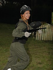 Tania Spice gets dressed up on her paintball gear and has some fun