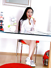 Horny Asian teen plays with her tight pussy on atop her desk