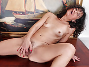 Anilos Penelope fingers her hairy pussy until she cums