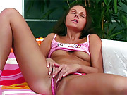 An angelic naked brunette hottie masturbates