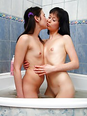 Two experimenting lesbians bathing together