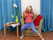 Teenage blonde reaching an orgasm on a chair