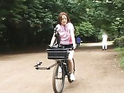 Anri Hiramatsu Asian walks in the park with bike rubbing her cunt