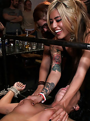 Beautiful brunette is tied up and whipped in front of a crowded bar before being spit on, fucked, and jizzed all over