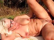 Granny gives a good tit wank