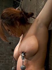 Hot Flexible Asian with big tits, has her feet caned. Her tits flogged, nipples clamped and weighted. Her leg pulled up and suspended! Made to cum!