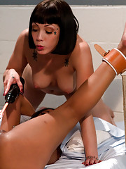 Skin Diamond and Asphyxia Noir play kinky lesbian sex games with electricity.