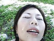 Japanese AV Model topless sucks two cocks outdoor getting cum