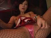 Japanese AV Model with broken fishnet rubs pussy over pink thong
