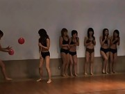 Japanese AV Model hits men with balls with other gals at gym