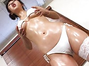 Maki Miyashita Asian with oiled body in white lingerie gets dildo