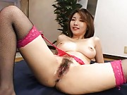 You Asian miss with fishnet stockings fucks herself with fingers