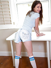 Brunette teen with perky tits wears long socks as she fucks a huge toy