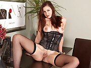 Busty red head Ariel plays with her pussy at her desk