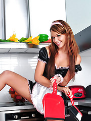 Check out this horny housemaid washing her pussy with water in the kitchen sink