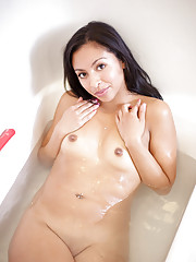 Nubiles Jenifer Curves masturbates with a sex toy in the bathroom