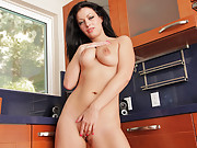 Angelica Raven strips in the kitchen and masturbates on the counter