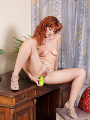 Office cougar Katia stretches her milf pussy with a vibrator
