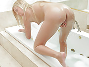 Nubile Callie Cobra takes a warm bath an fingers her cunt