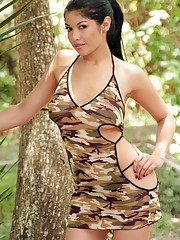 Natalia Spice goes to the woods and slides out of her camo bikini to reveal her big tits