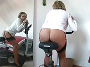 Milf masturbates on exercise bike