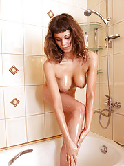 Gorgeous babe Gala takes a warm wet shower to freshen up her shaved pussy