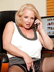 Rachel Love displays her big tits and shaved pussy in the office