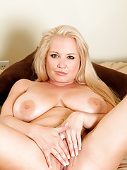 Busty Anilos Rachel Love shows off her huge tits and plays with her mature pussy